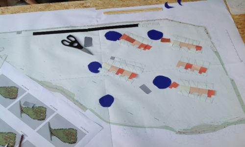Designing the site layout with scissors and cardboard