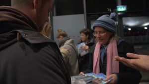 Corinne selling copies of '21 Stories of Transition'.