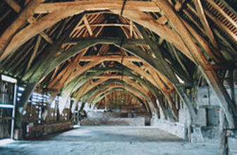 Big empty barn with huge wooden beams