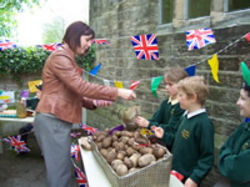 parent buying potatoes at pupils's stall