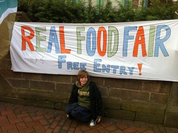 Banner saying Real food Fair plus young lad