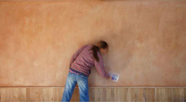 Katy earth plastering a wall
