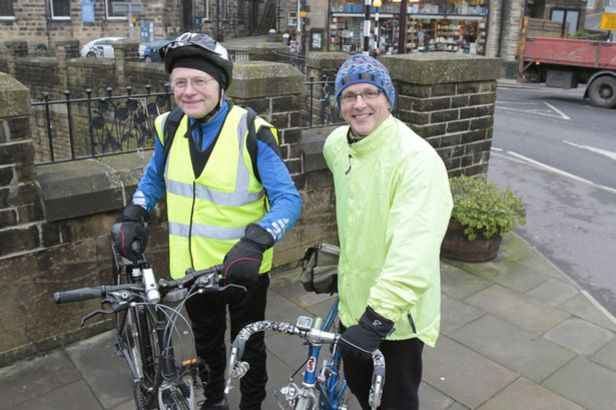 Martin Smith (left) and Nigel Peters of the transport group of Holmfirth Transition Town pictured in Holmfirth. Photo: Huddersfield Daily Examiner.