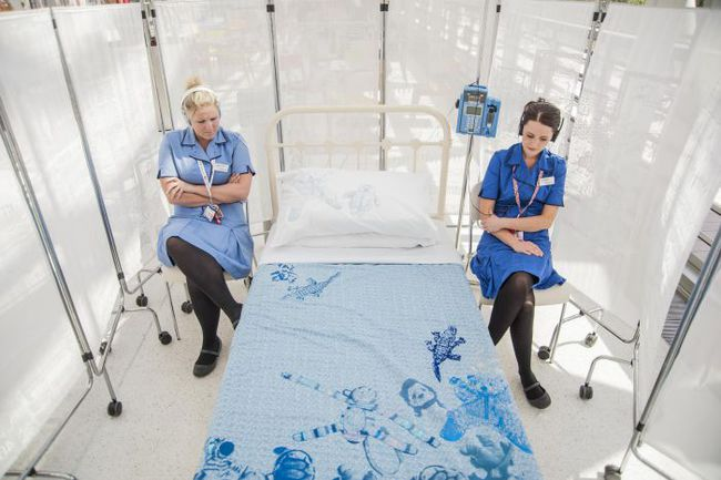 Nurses at Evelina London Children's Hospital listening to soundscape in Bedside Manners installation 2013. Artist Sofie Layton. Photo by Stephen King
