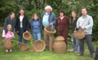 Basket weaving course, participants with finished baskets