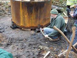 John Owen lighting the charcoal kiln