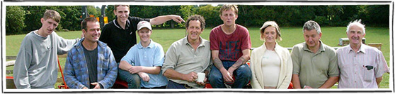 Monty don plus young people in project in a line in the sun