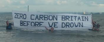 "ZCB campainers in the sea with banner ""ZCB before we drown"""