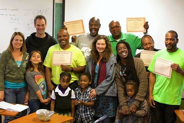 Participants receiving their Permaculture Design Certificates.