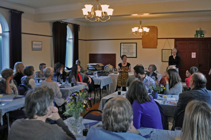 Holly Tiffin speaking at 'Oat Cuisine', a fundraising evening of oat-based dishes.