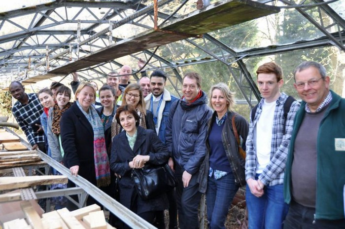 The group inside one of the greenhouses with Green Party leader Natalie Bennett.