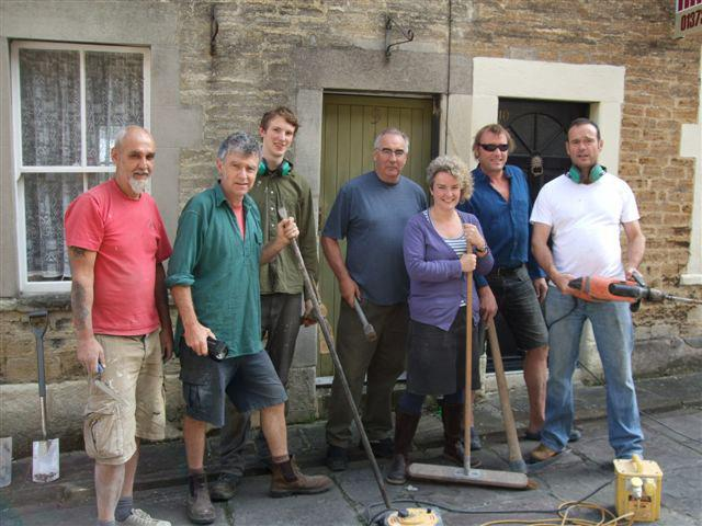 Some of the IFF councillors on a work day paving a street.