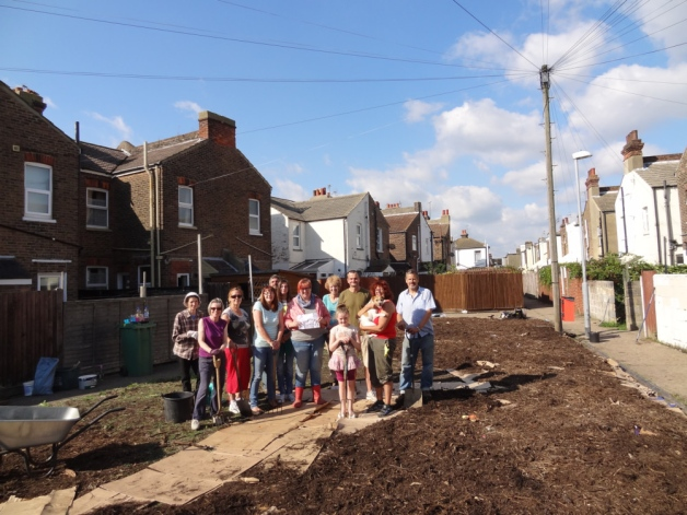 Local residents joined councillors Jim Murray and Steve Wallis, along with members of the Transition Town Eastbourne, to turn some wasteland between Dursley Road and Winchcombe Road into a new community garden (Photo: Eastbourne Herald).