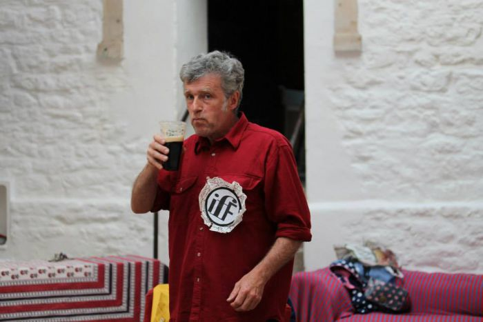 Peter indulges in some liquid refreshment at an IFF meeting.
