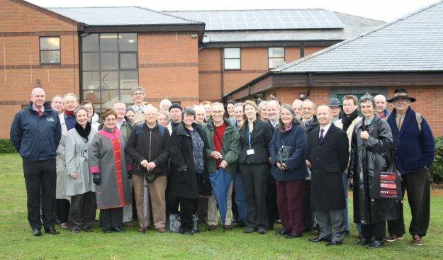 Community Energy Warwickshire shareholders at CEW's first installed solar panel array on Stratford-upon-Avon Hospital.