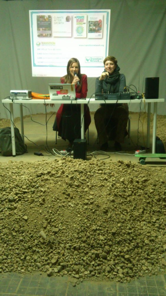 Emma and translator Anna Nikolaevna Schastlivaya sit behind a pile of rubble at the film festival.
