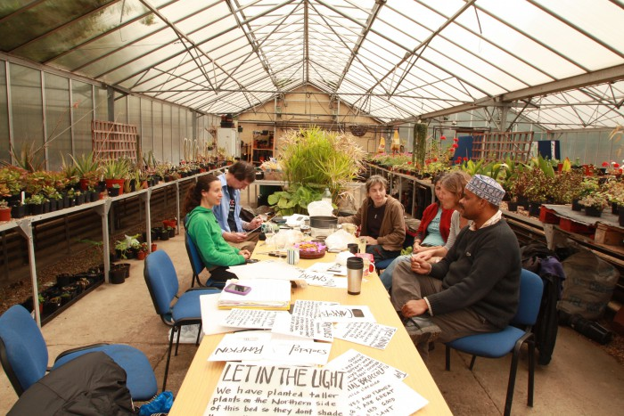 Transition Finsbury Park (London) meeting in a greenhouse.