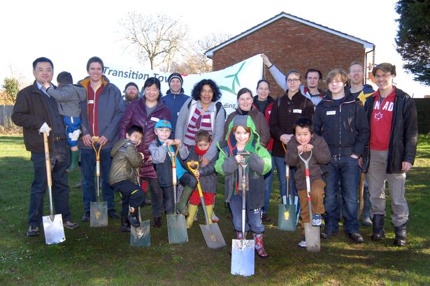 Woodley volunteers gather at Woodford Park to plant an orchard as part of Transition Town Reading.
