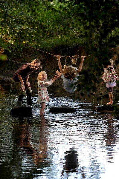 Children play in the stream at Transition Camp '13 – David Spink / Mike Grenville