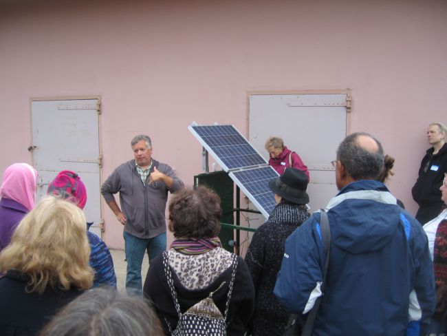 Learning about solar power from the guy from the Mid West Renewable Energy Association.