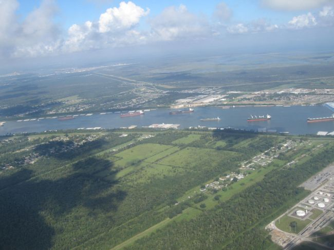 Refineries and tankers near New Orleans from the air.