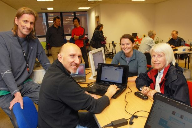 Nathan Perrin and Pete Ruczynski help Maggie Shutt with her computer as event organiser Rachel Miller looks on at last year's repair cafe