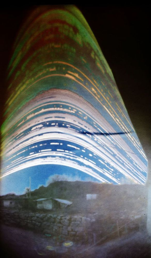 Sun paths at Abrazo House, taken with a pinhole camera exposed for 6 months