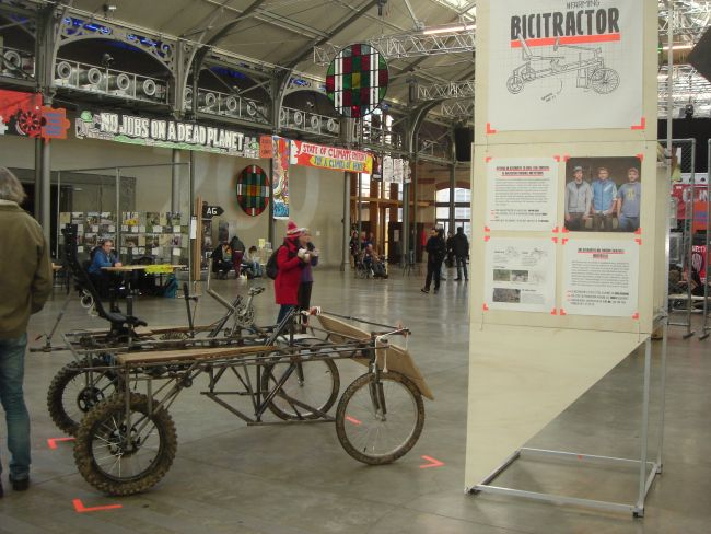 A pedal-powered tractor on display in the main hall of the ZAC