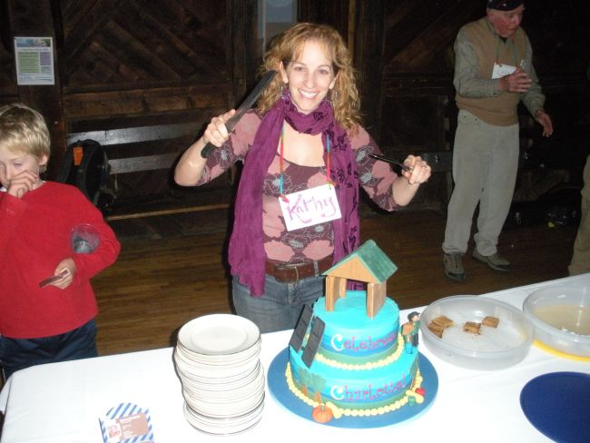 """Emcee Kathy Blume climaxes the Celebrate Charlotte's Future party at The Old Lantern by serving up a special """"birthday"""" cake."""