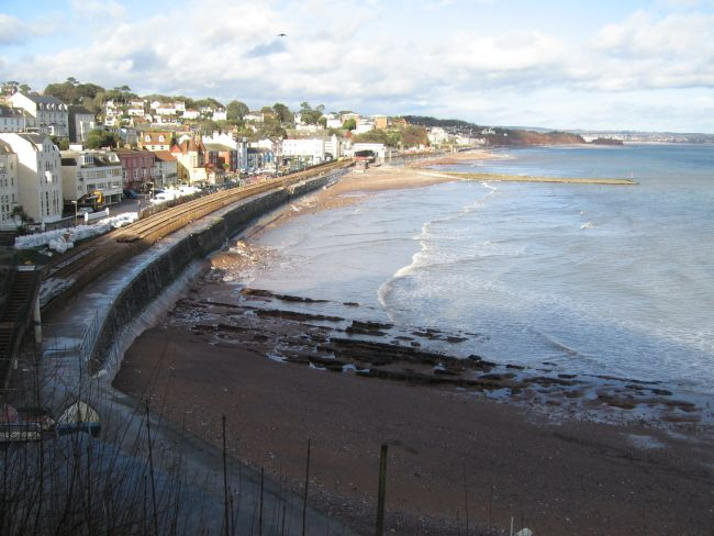 Dawlish.  If you look very closely to the right hand end of the train track you can see the repair work taking place after the sea wall collapsed into the sea.