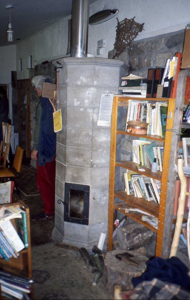 The masonry stove in the Middlewood Study Centre ('teacher' Rod Everett can be seen emerging from behind it).