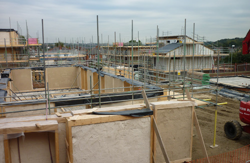 Strawbale walls under construction.