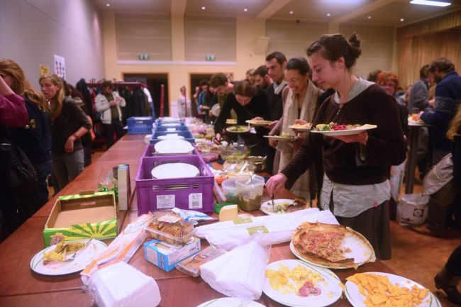 The potluck supper disappearing fast: Photo - Joanne Theisen.