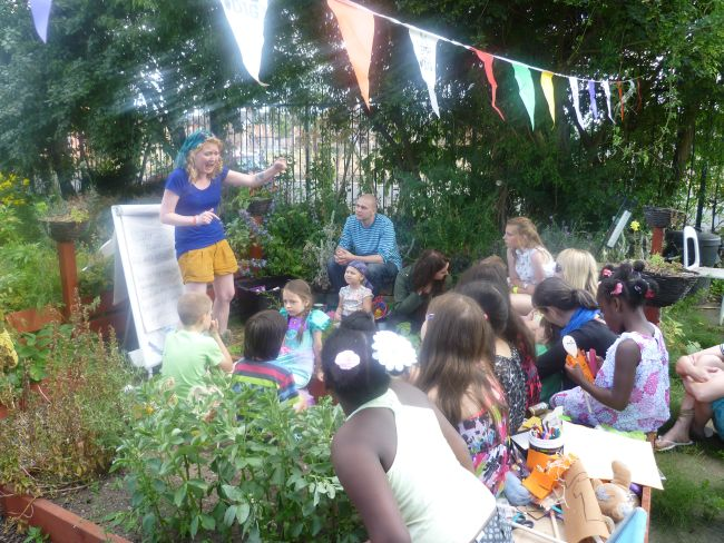 Hayley telling a story at our Village-in-the-City allotment open day.