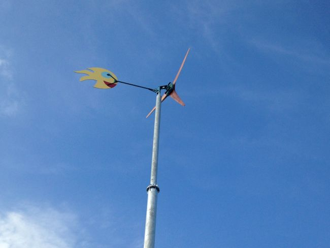Wind turbine up and working. The tail fin was painted by local school children.