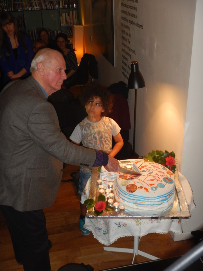 Photo by James Illman. Michael and Buddy get ready to cut the Playing for Time cake
