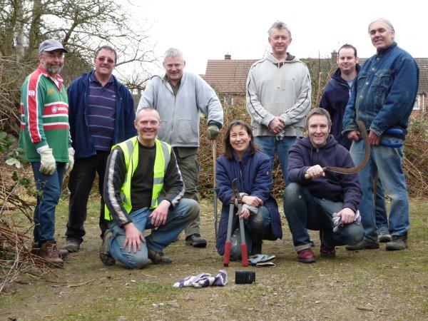 Members of Transition Market Harborough clean up the disused garage site they hope(d) will become a community farm.