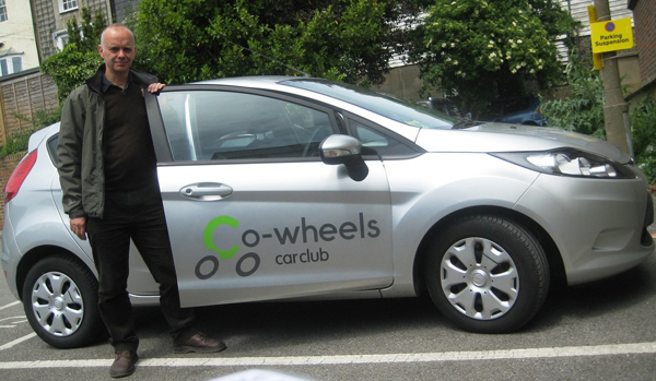 Chris Rowland using the Co-wheels car to take meter readings for OVESCO