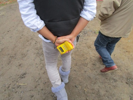 Carrying a personal geiger counter to measure radiation