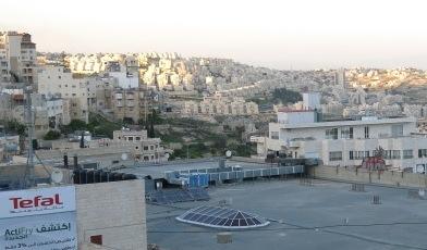israeli settlement over bethlehem rooftops