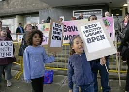 protest at closure of library, kids with placards